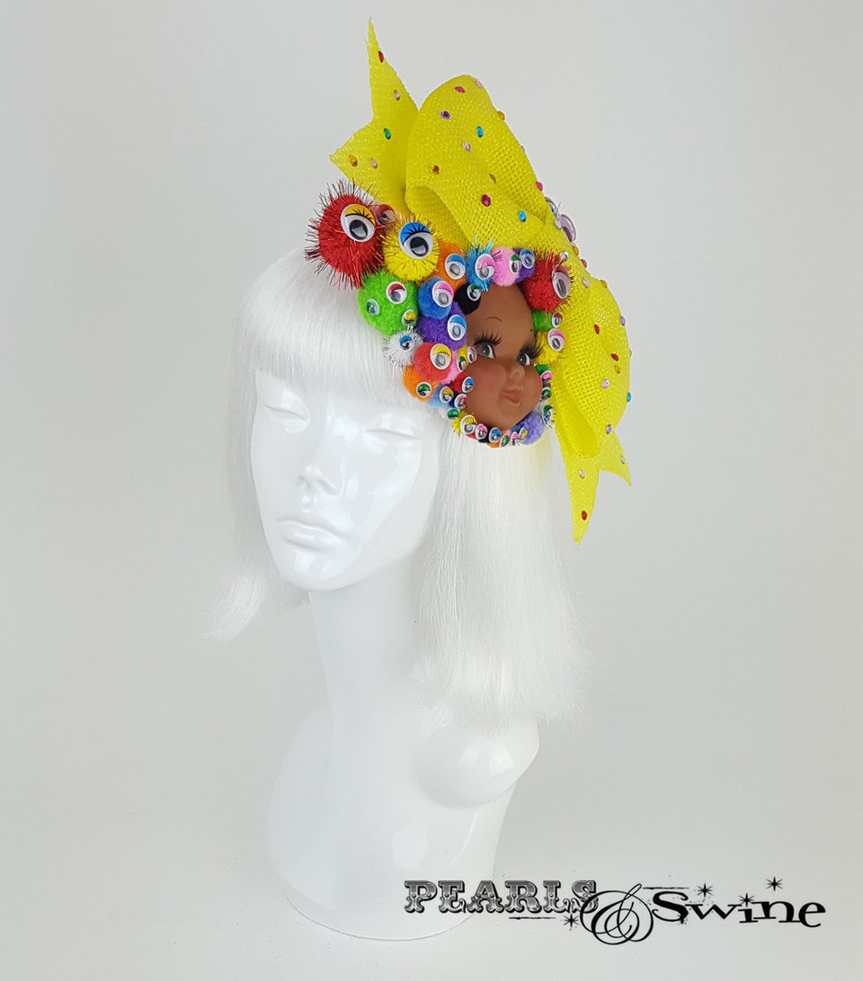 bow pom pom wiggly eye doll face surreal fascinator UK