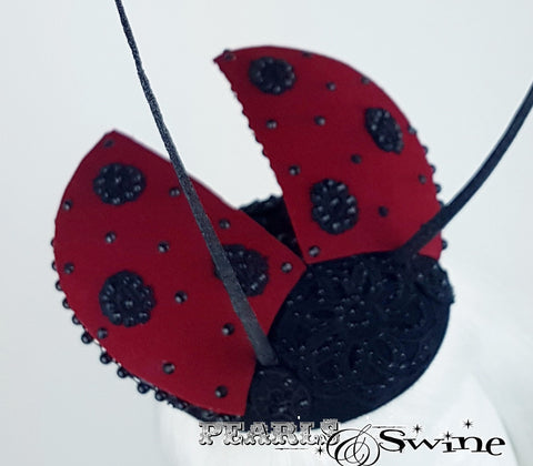 Lace and bead ladybird hat