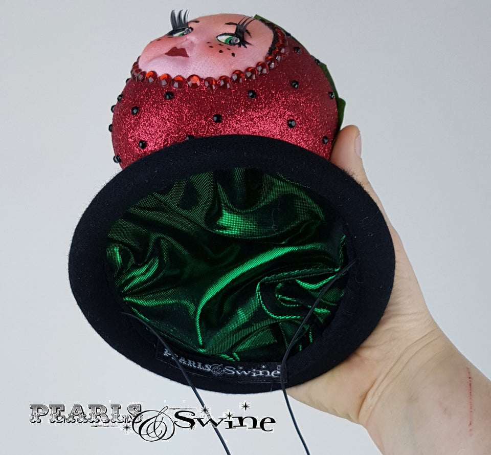 Metalic green lined doll face strawberry hat