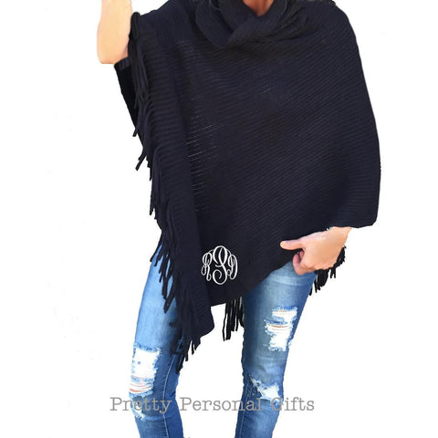 black poncho with monogram