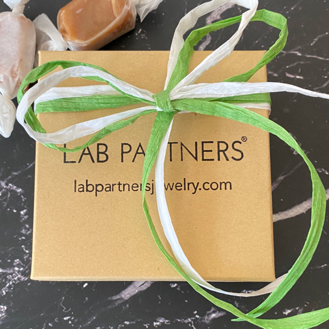 Lab Partners Jewelry kraft colored box with logo and green and white bow