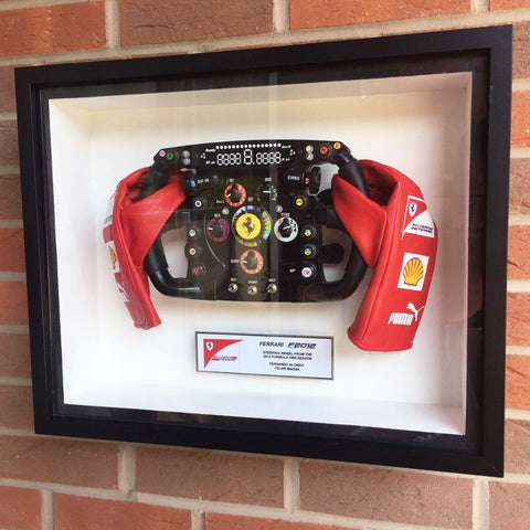 Fernando Alonso replica F2012 steering wheel in display frame
