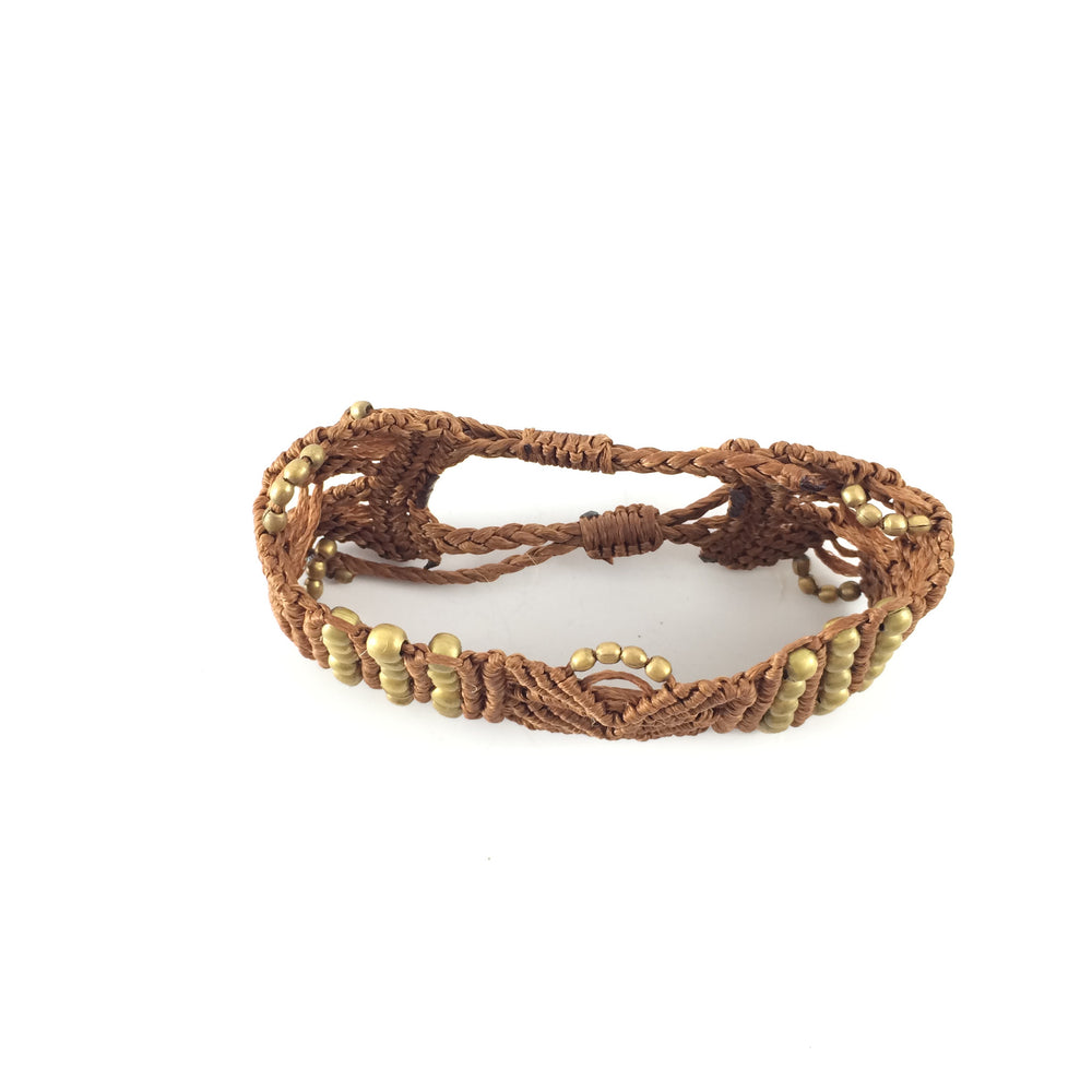 Bracelet handcrafted with Macrame art using highquality strings and brass elements