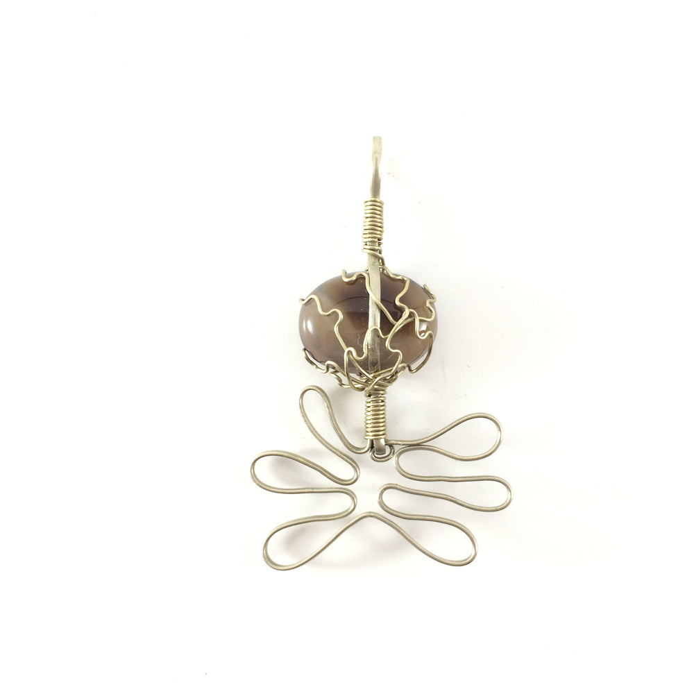 Pendant handcrafted from cat eye stone and Steel wire