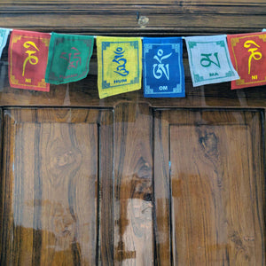 Prayer Flag Om Mani Padme Hum Cotton on home door closeup