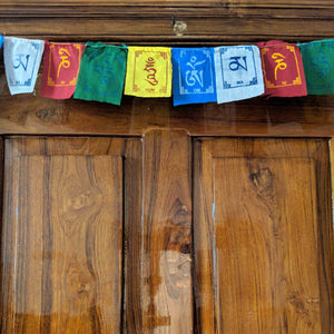 Prayer Flag Om Mani Padme Hum Cotton Mini on home door closeup