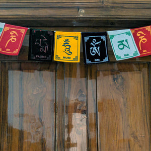 Prayer Flag Om Mani Padme Hum Velvet on home door closeup