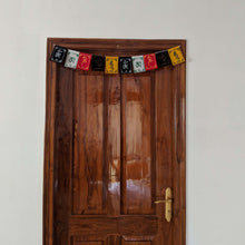 Load image into Gallery viewer, Prayer Flag Om Mani Padme Hum Velvet on home door
