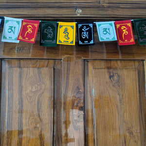 Prayer Flag Om Mani Padme Hum Velvet Mini on home door closeup