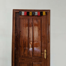 Load image into Gallery viewer, Prayer Flag Om Mani Padme Hum Velvet Mini on home door