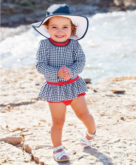 RuffleButts | One Piece Rash Guard ~ Navy Gingham Skirted