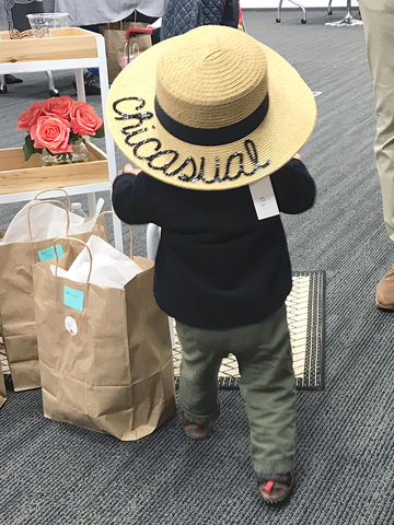 A baby wearing our signature straw hat is as cute as it gets.