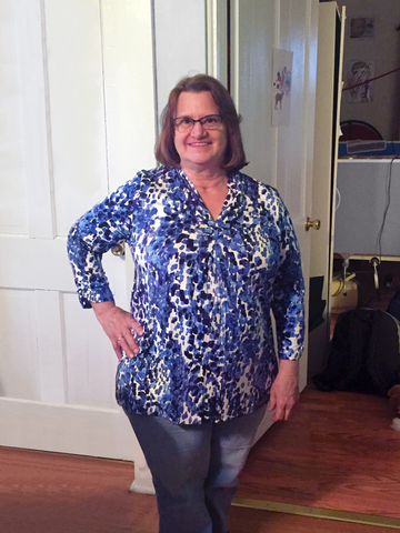 Our v-neck watercolor tunic with 3/4 sleeves is flattering on most body types.