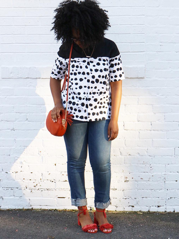 One of our favorite bloggers styling our bold and breezy polka dot top.