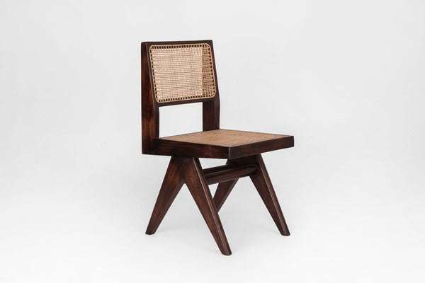 Pierre Jeanneret (1896 - 1967), Geneva, Schwitzerland.  The classic Student Chair from the Srelle Collection, made for the Punjab University, Chandigarh, India. Materials Used: Teak (origin: natural forests in Northern India) and natural cane.  Design Period: Mid 1950s. Wood chair, mid-century design. Danish design sale.