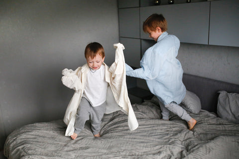 guest-bedroom-mattress-kids-playing-on-bed-king-size-queen-full-XL-beds-family-visiting-air-B-and-B