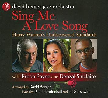 "Album cover reading ""David Berger Jazz Orchestra, Sing me a Love Song, Harry Warren's  Undiscovered Standards, with Freda Payne and Denzal Sinclaire.  Arranged by David Berger, Lyrics by Paul Mendenhall and Ira Gershwin.""  Photos of Berger, Payne, and Sinclaire agains a dark grey background."