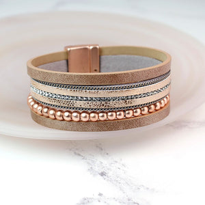 Rose gold multi strand bracelet with rose gold beads and magnetic clasp