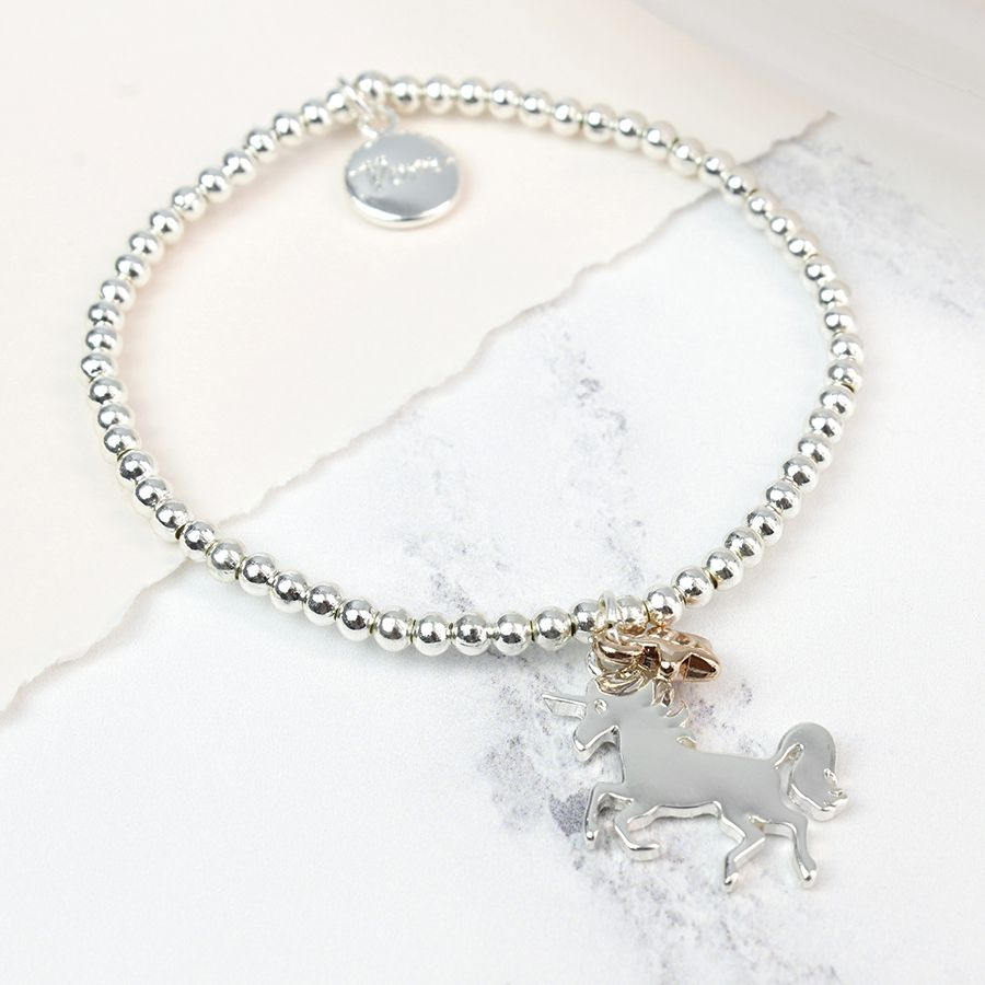 Silver beaded stretch bracelet with silver and gold unicorn charm