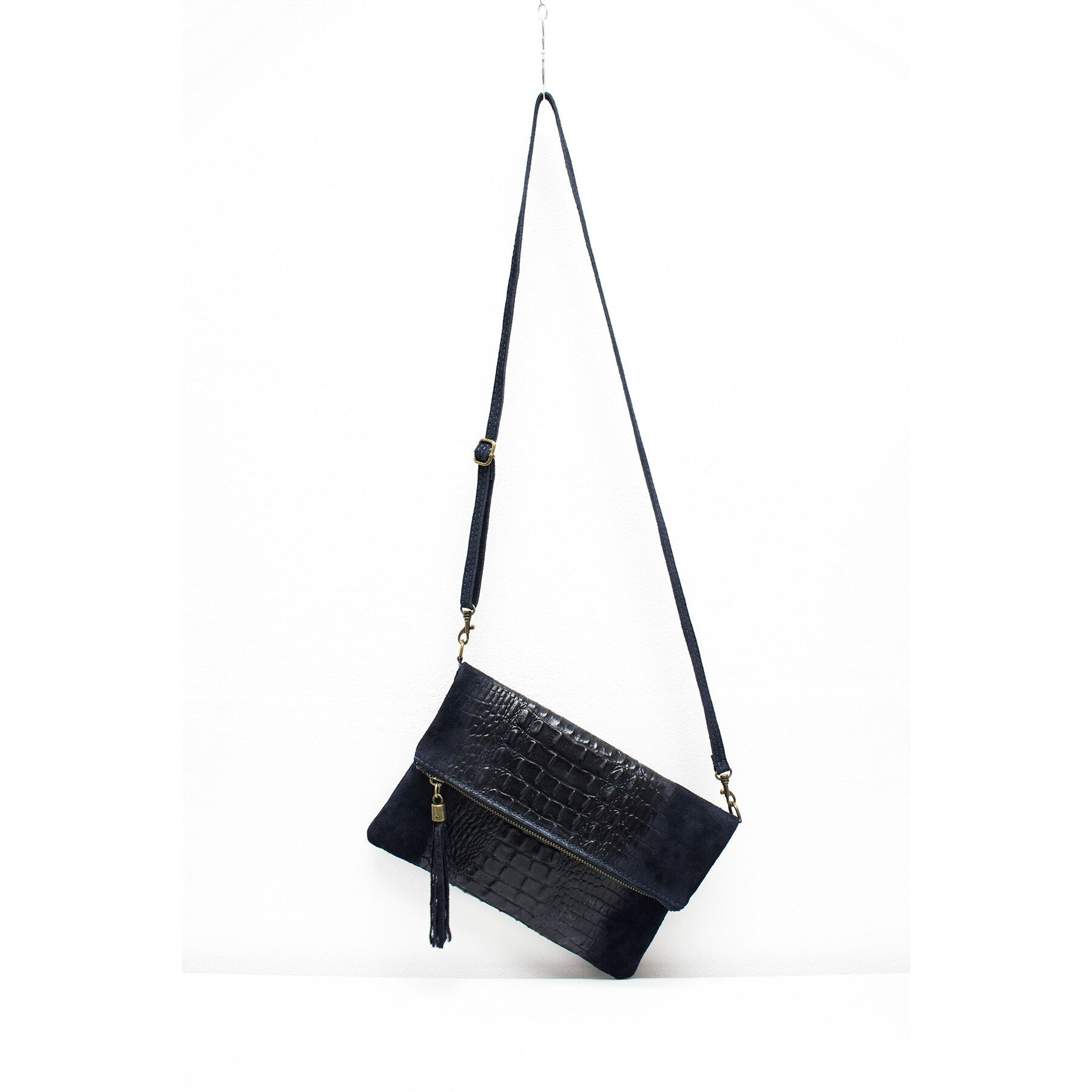 Navy suede and leather croc print fold over bag with long shoulder strap and tassel