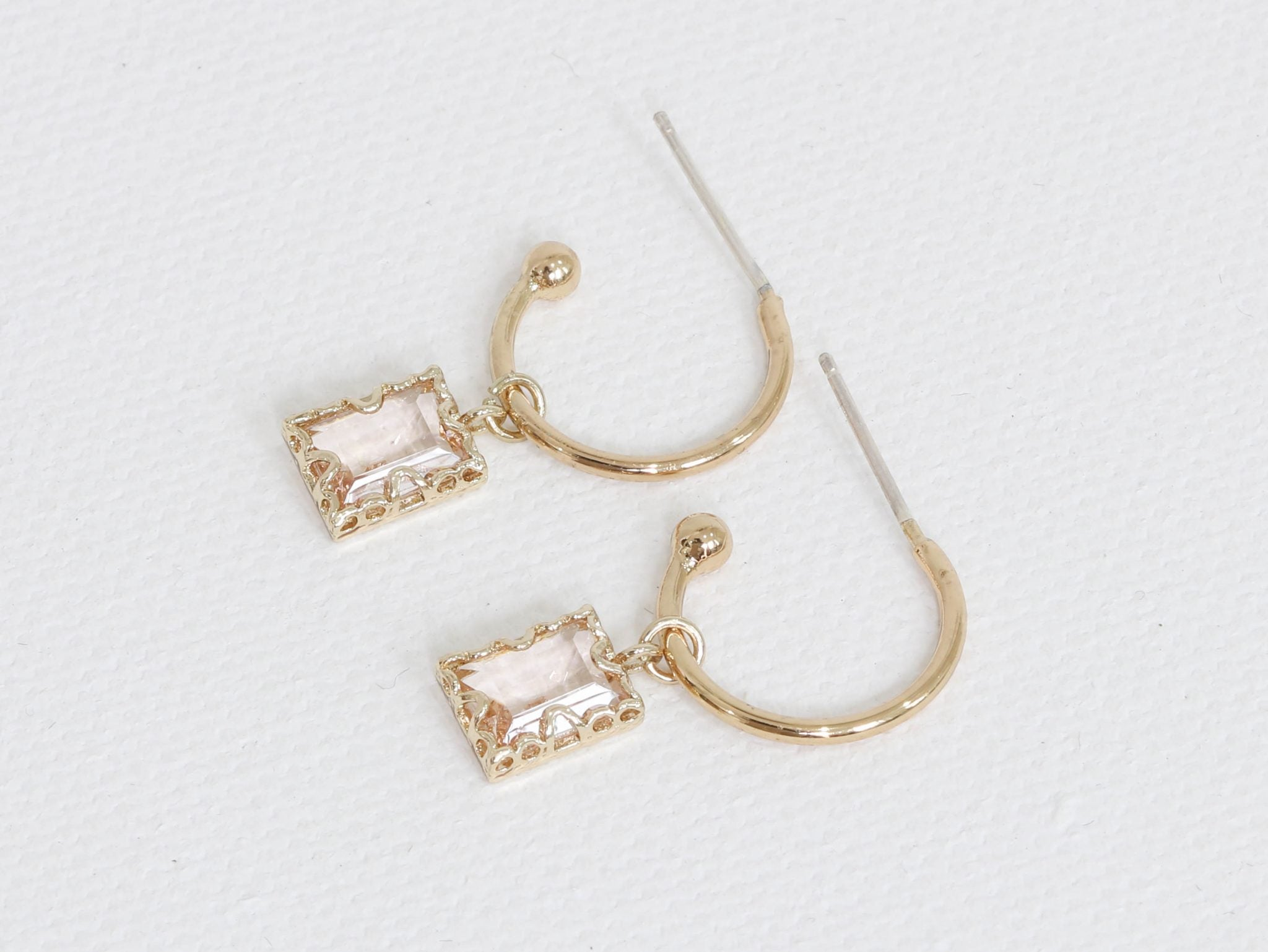 Small gold hoop earrings with pink crystals