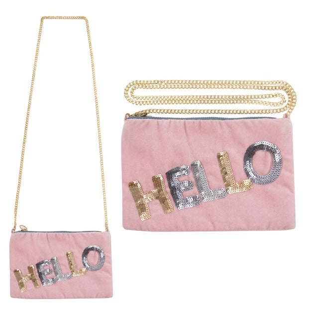 Pink velvet bag with gold chain strap and hello written on it in gold and silver sequins