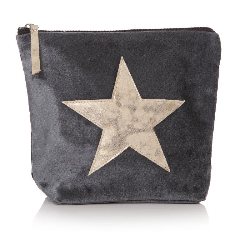 Grey velvet wash bag with gold star on front and gold pull tag