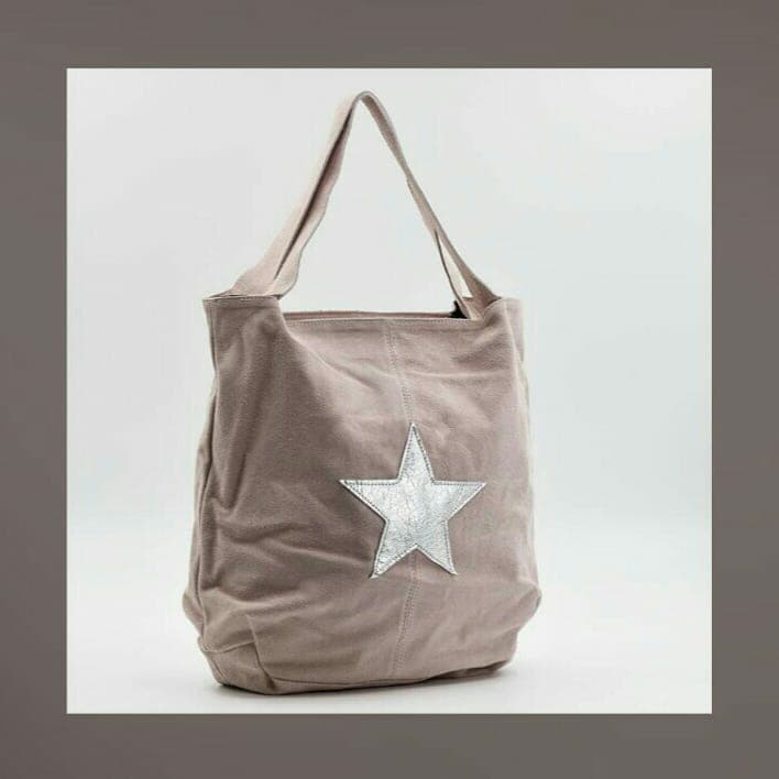 Light pink suede shoulder bag with silver star on front