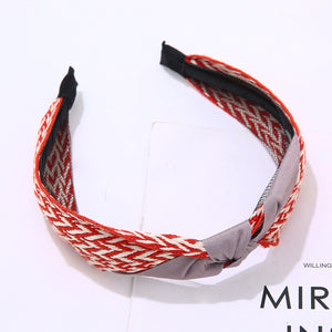 Red and white pattern hairband with grey ribbon knot
