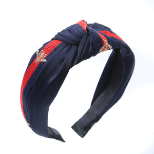 Navy hairband with red stripe and gold bee detail