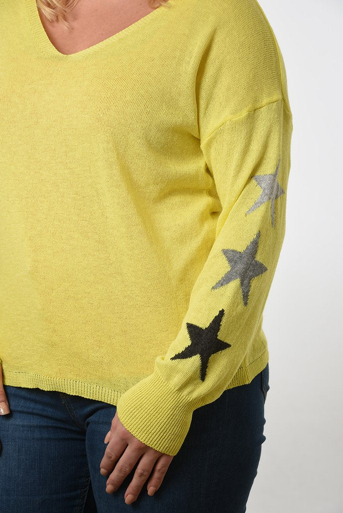 Yellow cotton v neck jumper with three grey stars on sleeves