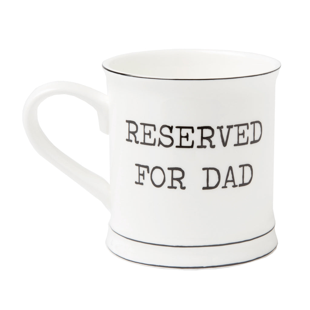White ceramic mug with reserved for dad writing in it