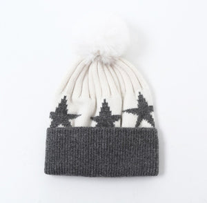 Cream woolly hat with grey fold over, grey stars and cream faux fur pompom