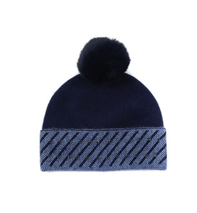 Navy hat with blue faux fur pompom and light blue and crystal trim