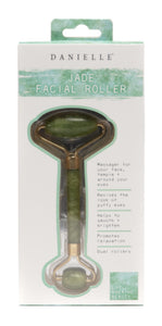 Package with jade facial roller