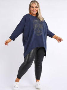 Model wearing plus size navy top with diamante skull on front