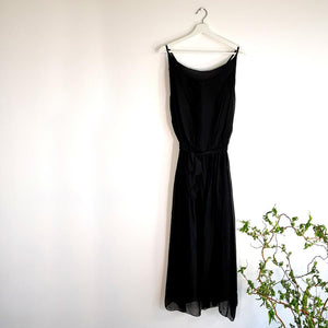Long black silk dress with spaggetti straps on a hanger