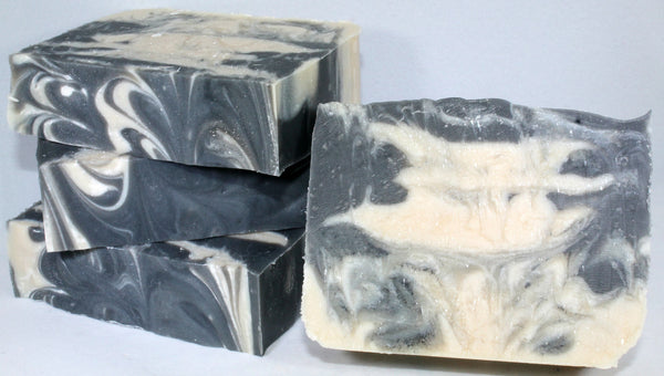 Whether you dream of smelling like Mr. Darcy or '007, this fresh and earthy soap is for you! Sophisticated ylang ylang entwined with citrus and green moss create a mature, refined scent. shea butter, coconut oil, and aloe juice ensure that your skin feels as good as it smells!  Ingredients:  Olive Oil, Organic Coconut Oil, Rice Bran Oil, Organic Shea Butter, Castor Oil, Aloe Juice, Purified Water, Sodium Hydroxide (Lye), Fragrance, Sodium Lactate, Active Charcoal Powder, Titanium Dioxide.  Our Soaps are han