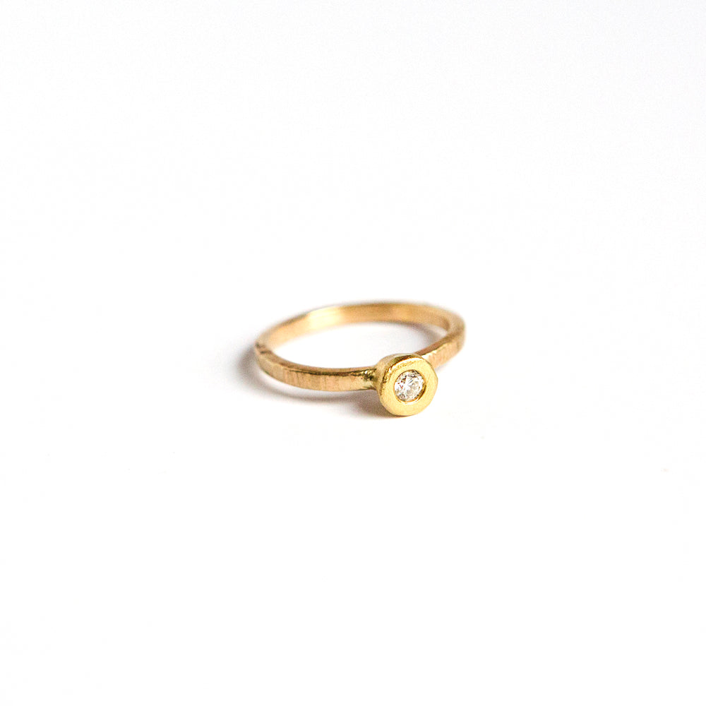 Textured Diamond Solitaire ring in 14k Gold