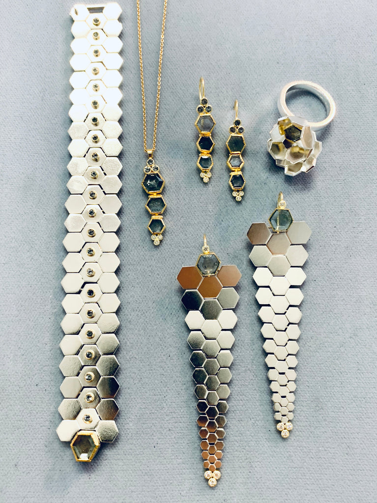 Facets collection in sterling silver, 18k and 22k gold, montana sapphires and gray spinels. Karin Jacobson Jewelry Design