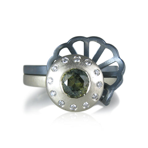 green sapphire with halo of diamonds