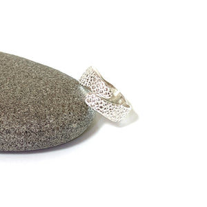 Adjustable Manta Ray Textured Silver Ring on pebble