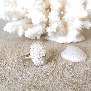 Pure Silver Ocean inspired Treasure Ring on sand