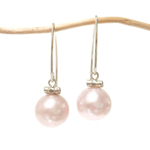 Blushing Pearl Drop Earrings on twig