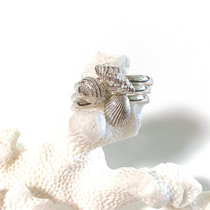 Silver Sea inspired Stacking Rings stacked on coral
