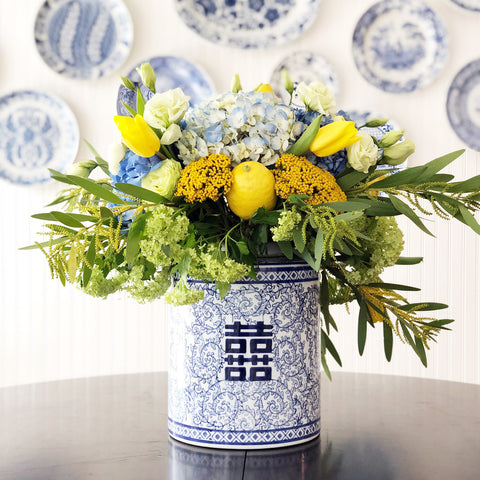 blue and yellow flowers in ginger jar