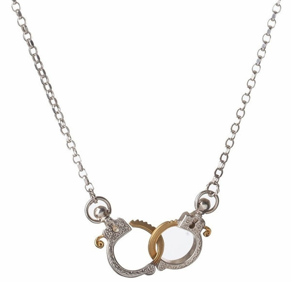 Jessica de Lotz JdL Jewellery Gladys Joyce Bowden Collection Mini Handcuff Necklace with Edwardian Pistol Engraving Closeup Sterling Silver with Gold Highlights