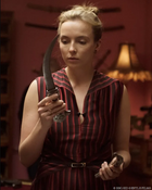killing eve villanelle holding dagger with jdl jewellery rings on hands copyright BBC America and Sid Gentle Films