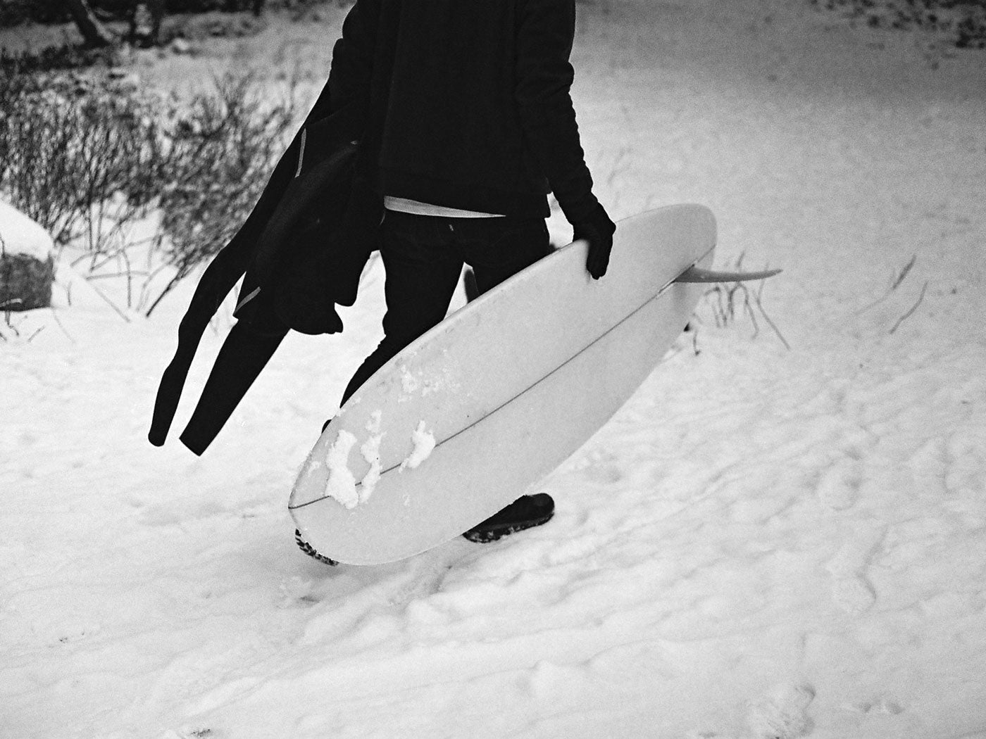 snow and self shaped stubbie surfboard
