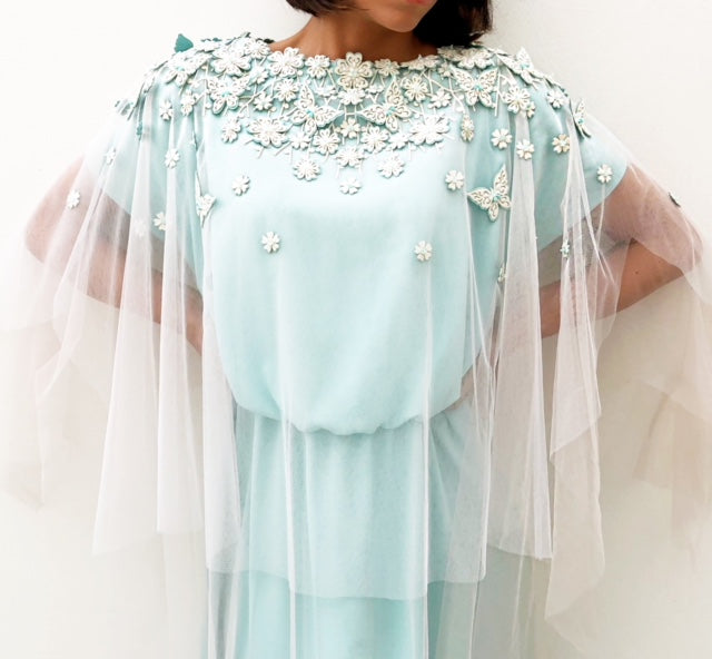 RAMADAN18 TURQUOISE CREPE DRESS WITH TULLE CAPE AND FLORALEMBELISHMENT
